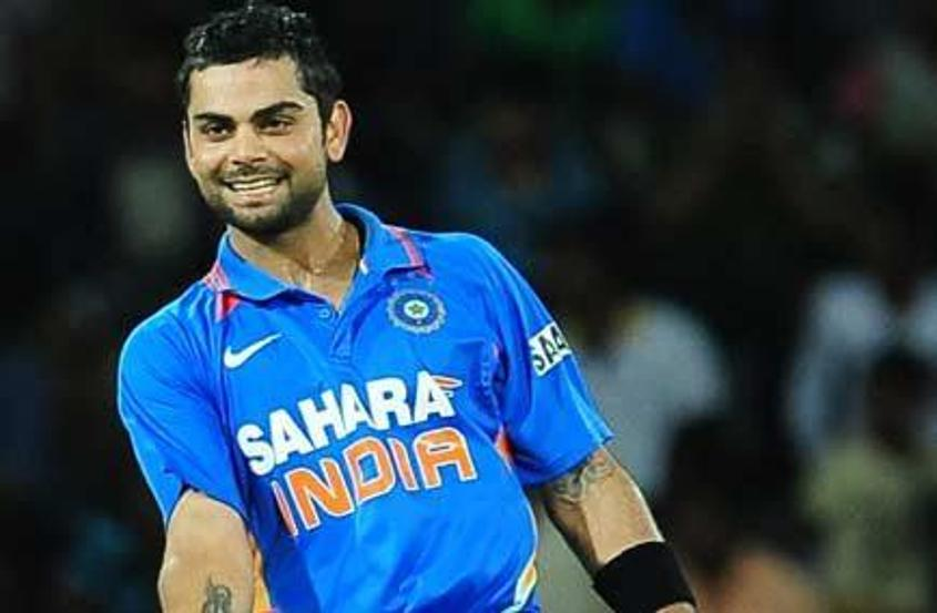 Virat Kohli celebrates his hundred and India's win