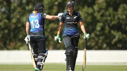 Suzie Bates of New Zealand is congratulated by Rachel Priest