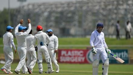 Afghanistan players celebrate after dismissing Gerrie Snyman