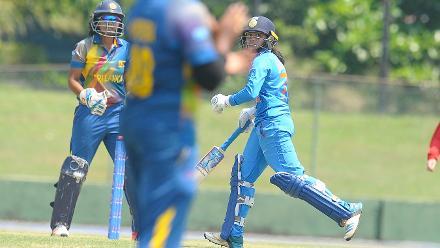 Devika Vaidya plays a shot