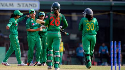 Sana Mir, the Pakistan captain, is congratulated by her teammates after picking up her 100th wicket.