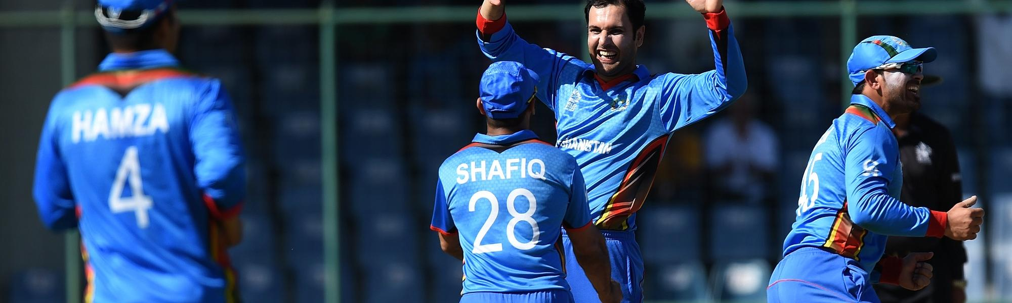 Mohammad Nabi (second from left) performed with bat and ball to help Afghanistan to a resounding win.