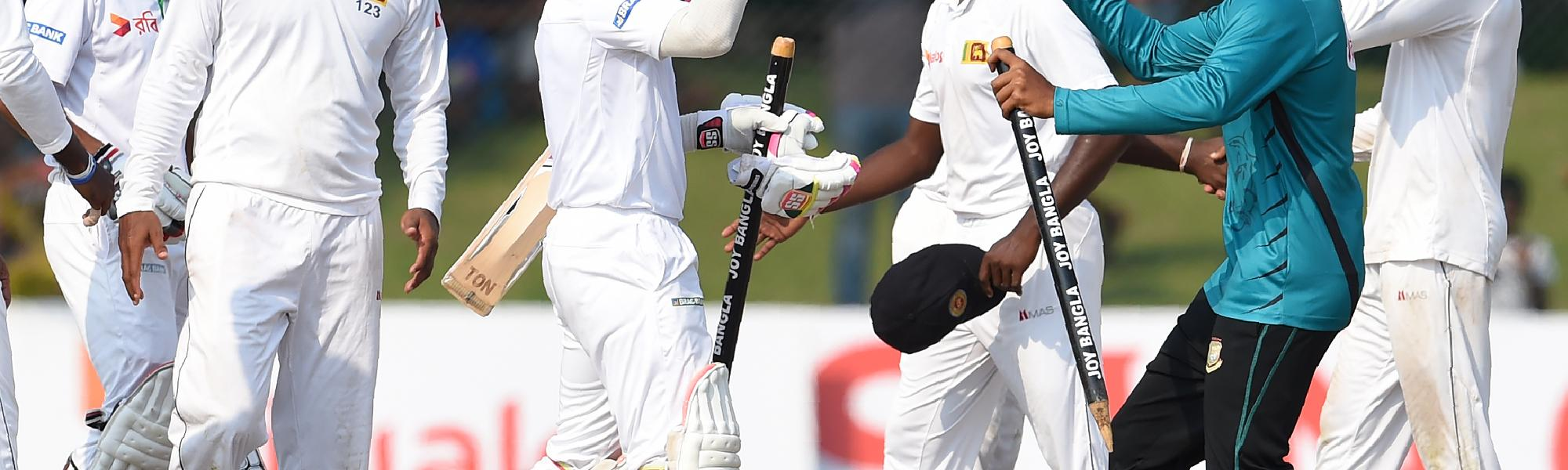 Bangladesh top off their 100th Test with a win