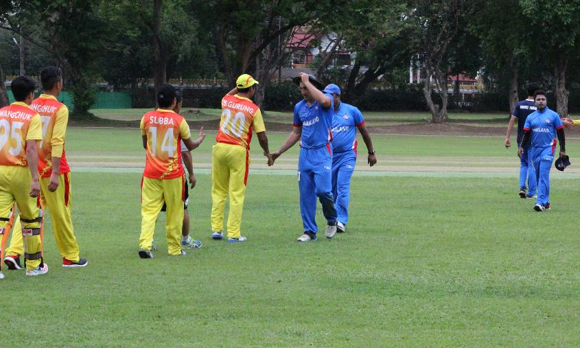 Bhutan and Thailand shake hands after their warm-up match before the ICC WCL Qualifier - Asia