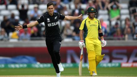 Trent Boult celebrates after dismissing David Warner