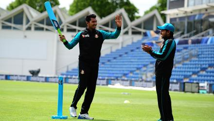 Soumya Sarkar and Mushfiqur Rahim of Bangladesh enjoy a game of cricket with local kids at the ICC Champions Trophy Cricket for Good clinic at  Cardiff, Wales.
