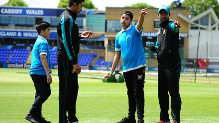 Sabbir Rahman and Soumya Sarkar of Bangladesh with young school during an ICC Champions Trophy Cricket for Good clinic at Cardiff, Wales