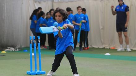 Local school children enjoy a game of cricket with the England players during an ICC Champions Trophy Cricket for Good clinic at Birmingham.