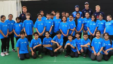 Jonny Bairstow, David Willey, Steve Finn and Sam Billings of England with local school children during an ICC Champions Trophy Cricket for Good clinic at Birmingham.