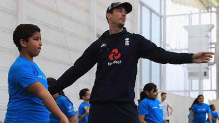 Steven Finn of England shows a young school kid the nuances of bowling during an ICC Champions Trophy Cricket for Good clinic at Birmingham.