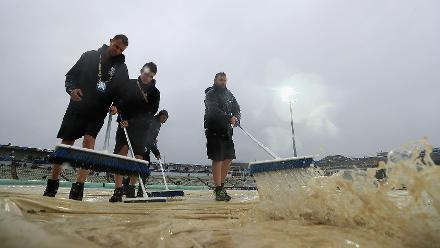 Rain led to an abandonment, handing England a 40-run win by the DLS method
