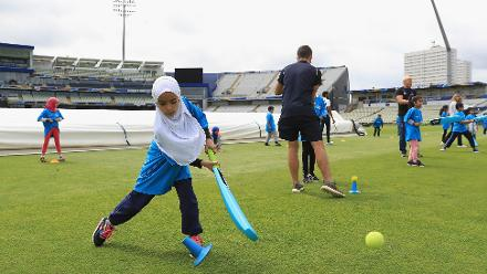 A local girl practices a shot at the Cricket For Good coaching clinic at Birmingham.