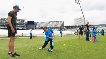 Mike Hussey oversees a girl practising a shot at the Cricket For Good coaching clinic at Birmingham.