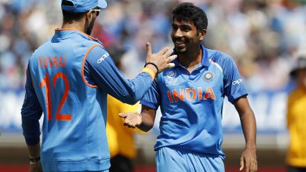 Jasprit Bumrah celebrates with Yuvraj Singh after taking the wicket of Mosaddek Hossain.