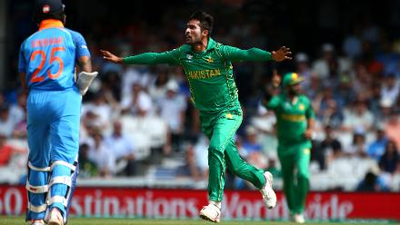 Mohammad Amir celebrates after dismissing Shikhar Dhawan for 22