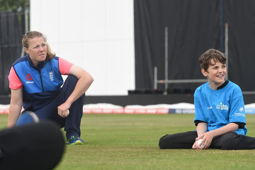 Anya Shrubsole of England Women's Cricket team pictured with local school children during the Cricket For Good clinic in Derby.