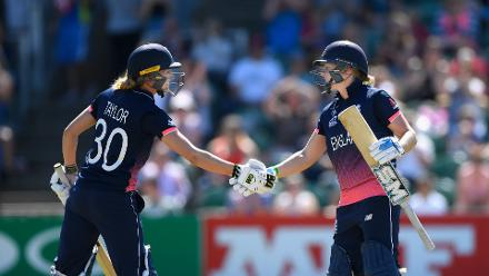 Heather Knight is congratulated on her half century by Sarah Taylor.