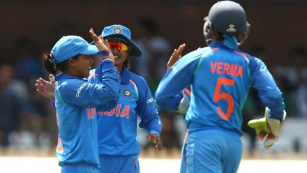 Ekta Bisht of India (left) celebrates taking the wicket of Sidra Nawaz of Pakistan during the ICC Women's World Cup match between India and Pakistan