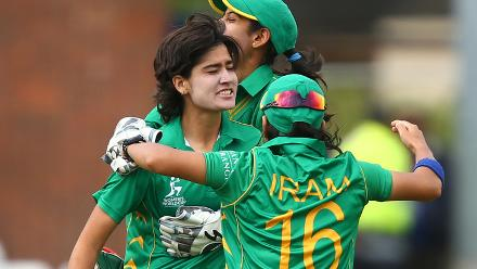 Diana Baig celebrates with Sidra Nawaz and Iran Javed after taking the wicket of in-form Smriti Mandhana.
