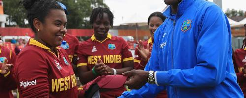 Vasbert Drakes, coach of West Indies presents Reniece Boyce with her first cap.