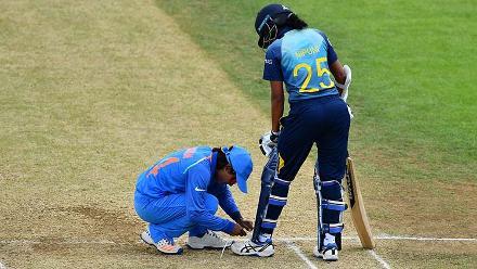 Poonam Raut helps tie the shoelaces of Nipuni Hansika
