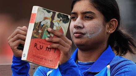 Mithali Raj enjoys a book before going out to bat
