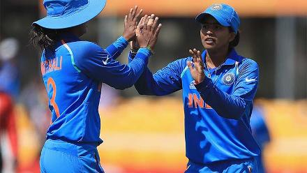 Ekta Bisht celebrates the dismissal of Trisha Chetty with Mithali Raj