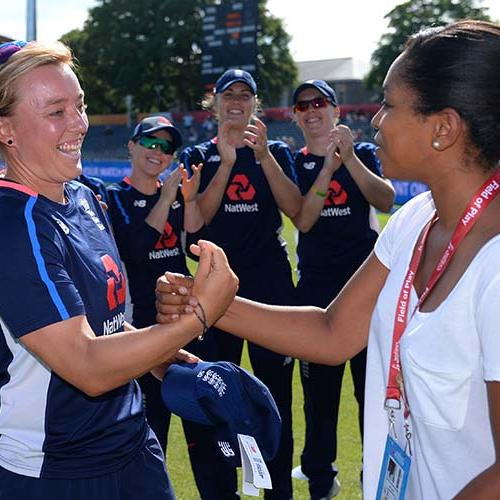 Danielle Hazell is presented with her 50th cap for England by Ebony Rainford-Brent