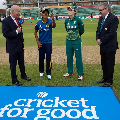 Ralph Dellor (L) and Match Referee David Jukes watch the coin toss performed by Inoka Ranaweera of Sri Lanka and Dane Van Niekerk of South Africa before The ICC Women's World Cup 2017 match.