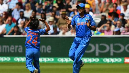 Poonam Yadav celebrates the wicket of Heather Knight with Jhulan Goswami