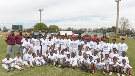 International players and the children they were helping during the 2017 ICC World Cricket League Division 5 South Africa's Cricket for good function at Sahara Willowmoore Park 1.