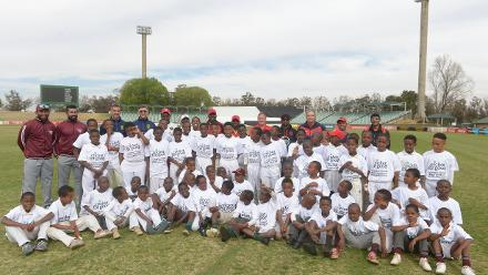 International players and the children they were helping during the 2017 ICC World Cricket League Division 5 South Africa's Cricket for good function at Sahara Willowmoore Park.