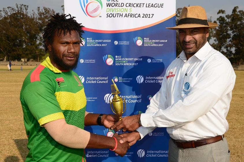 Patrick Matautaava of Vanuatu, the player of the match,  received the trophy from Graeme Labrooy.