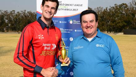 Player of the match, Anthony Hawkins-Kay of Jersey receives his trophy from Alex Dowdalls during day 4 of the 2017 ICC World Cricket League Division 5 match between Qatar and Jersey.