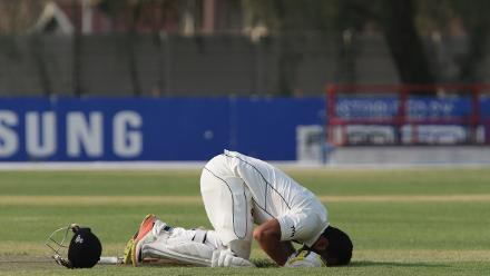 Adnan Mufti kisses the ground after scoring a century against Namibia in Windhoek on 16 September 2017. © ICC/Helge Schutz
