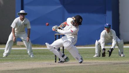 UAE batsman Imran Haider takes evasive action against a JJ Smit bouncer on 18 September 2017. © ICC/Helge Schutz