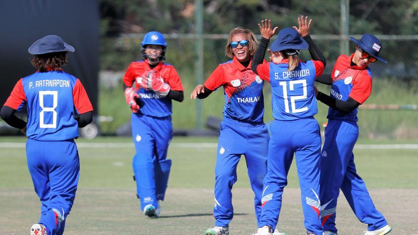 Thailand celebrate a wicket against Hong Kong. © Abhilasha Agarwal – Winsports India