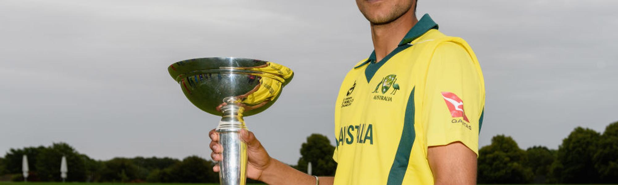 Australia captain Jason Sangha poses with the ICC U19 World Cup trophy during the 2018 event's opening ceremony