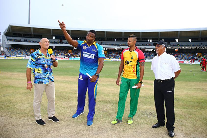 Danny Morrison (left) at the toss during a Caribbean Premier League match