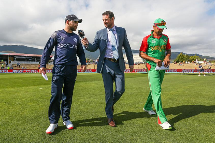 Simon Doull (centre) during the clash between Bangladesh and Scotland at the ICC Cricket World Cup 2015
