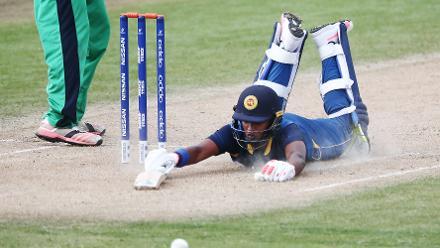 Dhananjaya Lakshan of Sri Lanka dives to make his ground