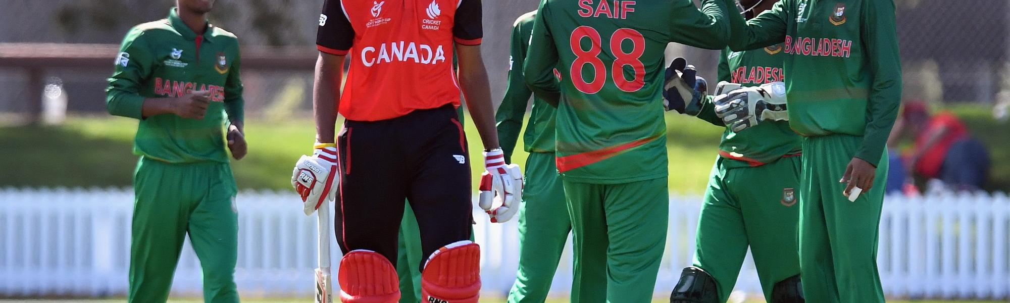 Akash Gill of Canada looks dejected after being dismissed by Mohammed Saif Hassan of Bangladesh