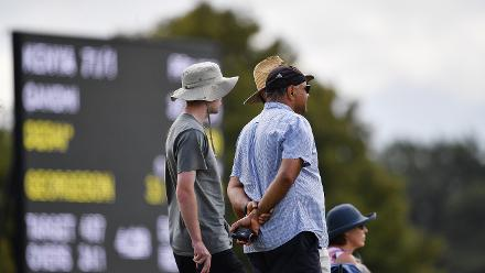 Spectators watch on from the boundary