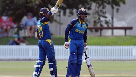 Dhananjaya Lakshan of Sri Lanka celebrates scoring a half century