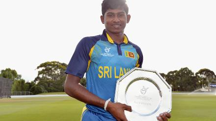 Captain Kamindu Mendis of Sri Lanka poses with the plate