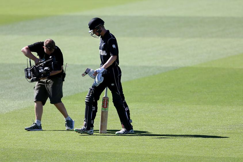 New Zealand's Luke Georgeson leaves the field after being dismissed