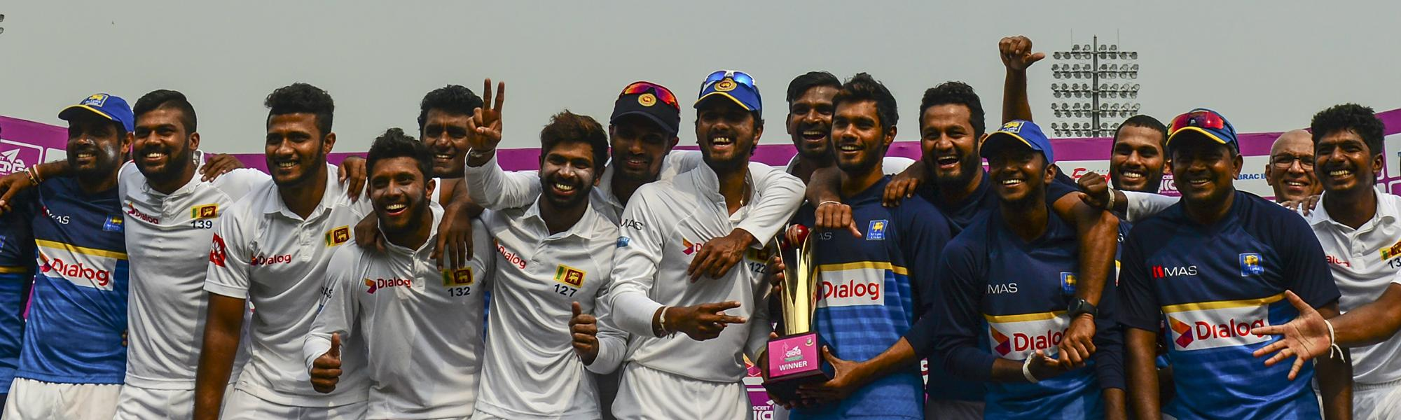 The Sri Lankans pose with their spoils after winning the two-Test series in Bangladesh.