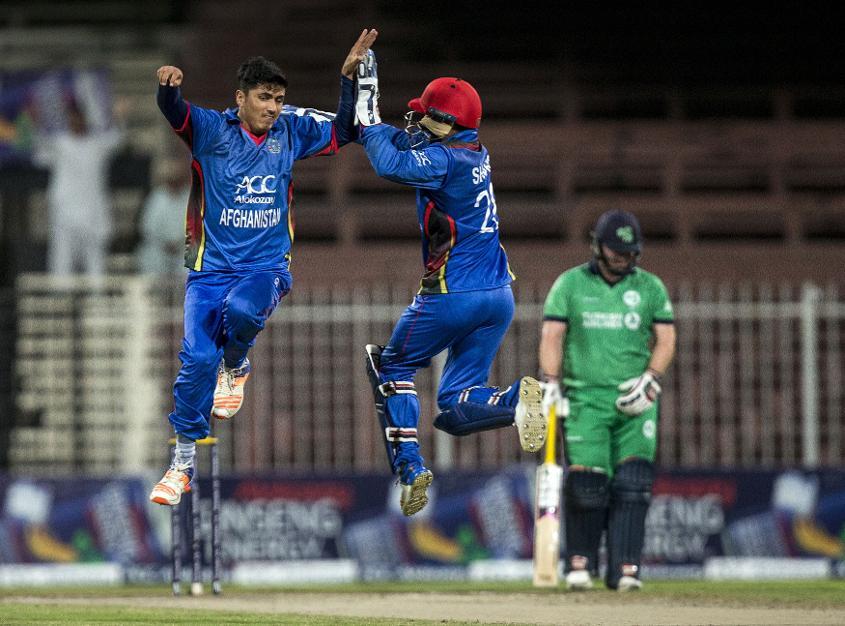 Mujeeb Ur Rahman celebrates a wicket