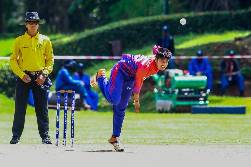 Nepal bowler Sandeep Lamichhane bowls during a World Cup Qualifier play off cricket match between Nepal and Papua New Guinea at Old Hararians Sports Club March 15 2018 (©ICC).