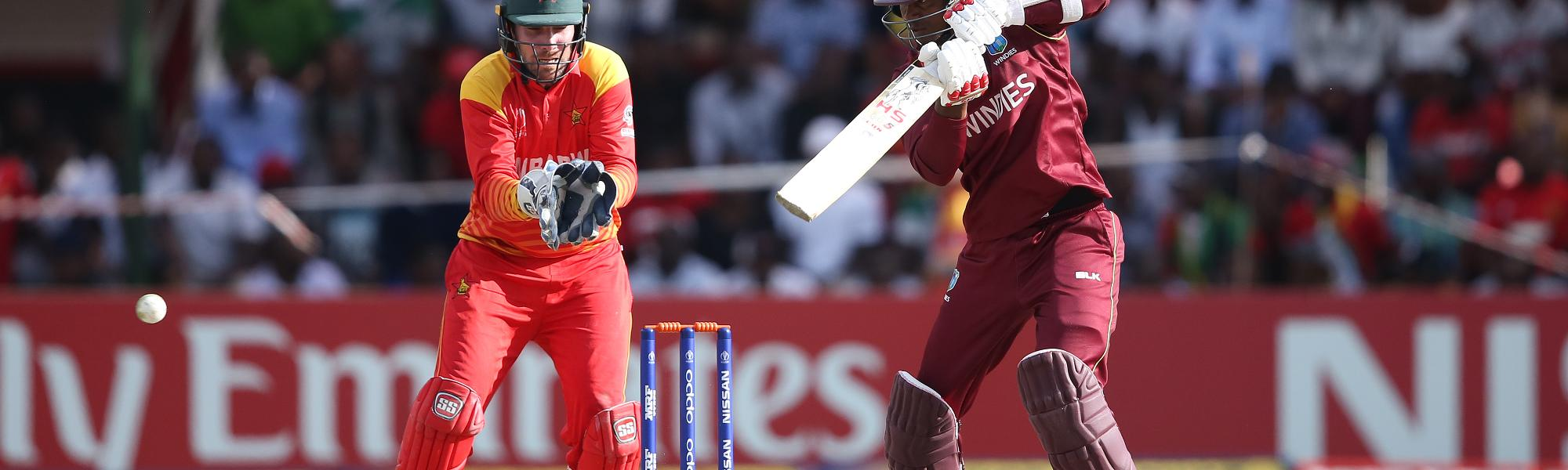 Brendan Taylor of Zimbabwe looks on as Marlon Samuels of The Windies scores runs during The Cricket World Cup Qualifier between The Windies and Zimbabwe at The Harare Sports Club on March 19, 2018 in Harare, Zimbabwe (©ICC).